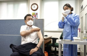 The Latest: Dr. Fauci: Be sure to get 2nd dose of vaccines
